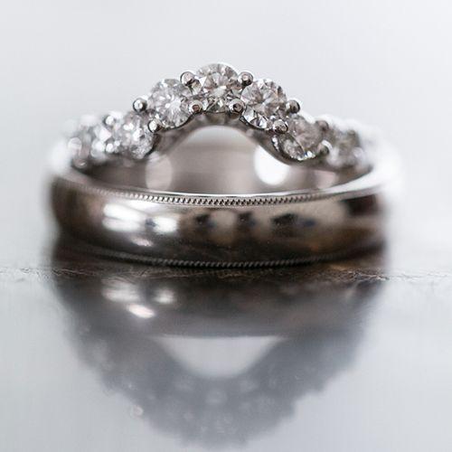 Shirleys diamondstudded wedding ring atop Bernies classic silver