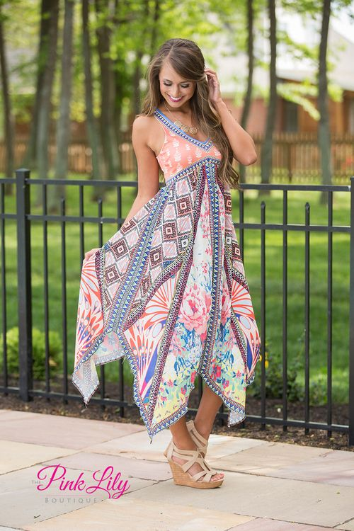 We adore the vibrant color combination and patterns on this dress! It combines a rainbow of colors with floral and geometric patterns to create a knockout dress! To top it off, it has a peach bodice with a floral white pattern. It also has a v neckline, an empire waist, a racerback, a zipper in back, and a wide, flowing skirt.