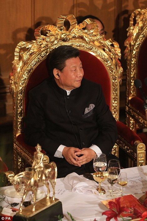 President Xi Jinping listens to a translated speech