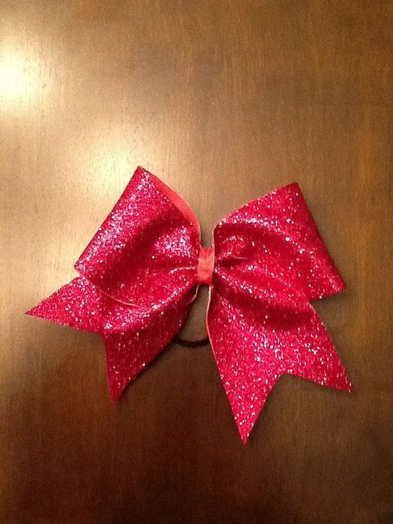 This #sparkly #red #hair #bow can be found on etsy.com for around twelve dollars along with many other #college #hair #bows.