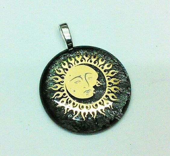 Check out this item in my Etsy shop https://www.etsy.com/listing/237485311/goldem-sun-and-moon-pendant
