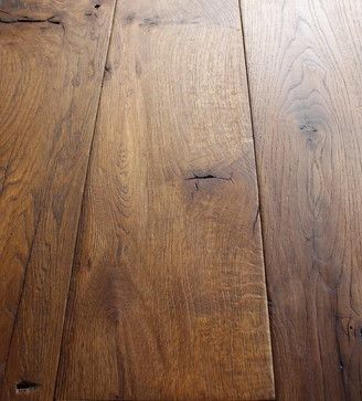 Reclaimed French Oak Wide Planks - Salvaged from the Provence region in France. The wood has been scraped, brushed and lightly smoked for a deep and warm patina.