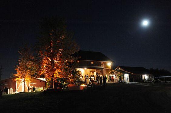 Michigan outdoor barn wedding at lights up at night.