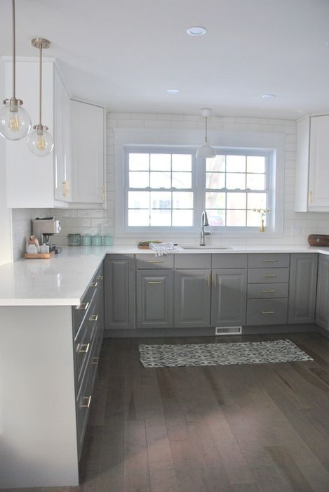 A gray and white kitchen makeover using IKEA cabinetry, quartz countertops, subway tile, & gold hardware. Click through for the full source list & how-to's!14