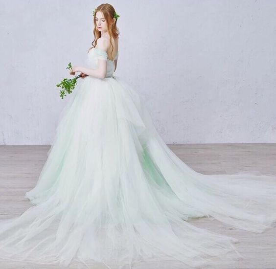 Color wedding dress | Mint green | This is amazing! Head over to Fairy Couture where you can see more of their unique works http://www.bridestory.com/fairy-couture/instagram