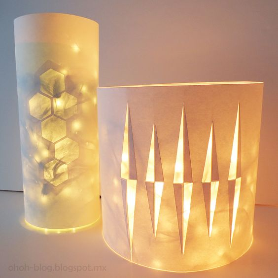 @Ohoh Blog has a gorgeous way to modernize your home decor without spending money. You'll have a new use for your Christmas lights throughout the year with a paper craft that's simple, but enchanting to the eye.