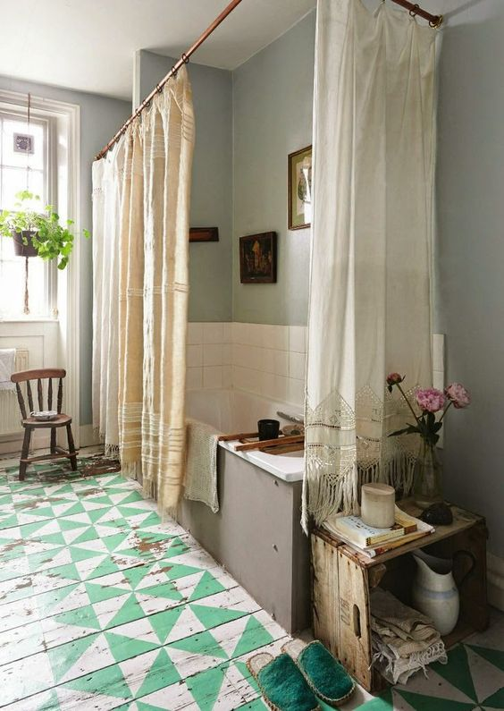 Love this boho shabby chic bathroom with sea foam pinwheel painted floor, mismatched linen curtains and a hanging houseplant, of course!