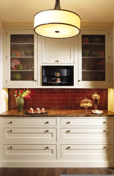 modern take on a butler's pantry - love the red tile and drum shade!