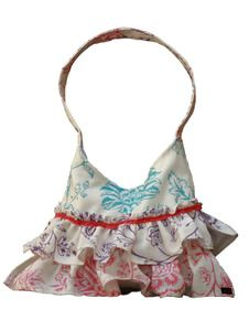 The small floral bag with ruffles is made from white linen fabric and remnants with a white satin lining. It also comes with two internal pockets and a magnetic snap closure. $25