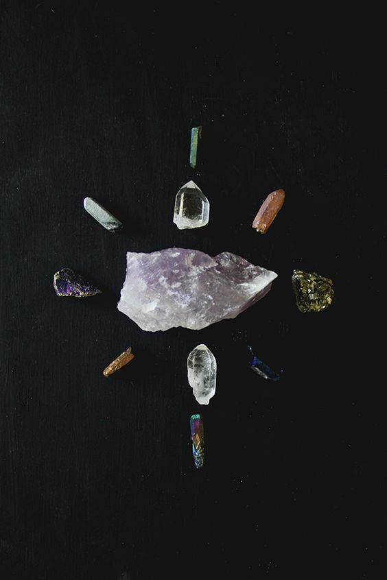7. Create a display masterpiece. There is something so meditative about mindfully arranging crystals and other stones in your own beautiful designs. Do this on a dresser or table and change the design whenever the mood hits.