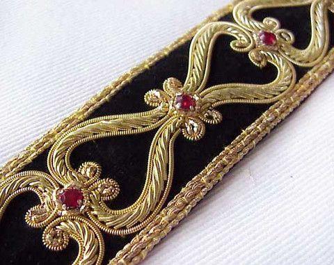 An elegant trim with bullion and rhinestones on black velvet.