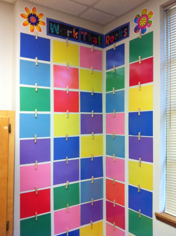 Displaying student's work - laminated pieces of construction paper and clothes pins with thumb tacks hot glued to back...