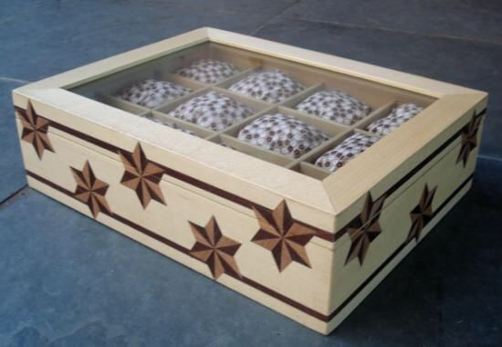 Imagem de http://pt.artesanum.com/upload/postal/1/8/7/caixa_para_relogios_pulso_e_bo-80132.jpg.