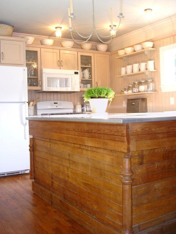 This homeowner turned an old hardware store counter into a massive, storage-filled kitchen island. An inexpensive galvanized steel top completes the look.