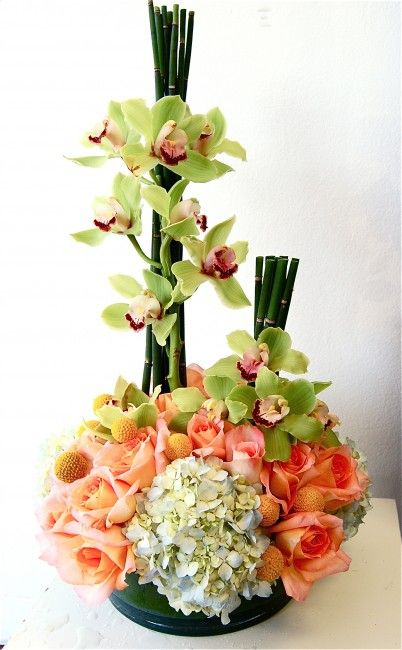 Centerpiece of coral peach roses with craspedia horsetail