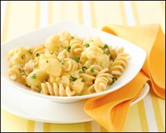 HG's Too-EZ Mac 'n Cheese  Ingredients:  6 cups (about 24 oz.) frozen Green Giant Cauliflower & Cheese Sauce  2 cups uncooked Ronzoni Healthy Harvest Whole Wheat Blend Rotini Pasta (or another whole-wheat or whole-wheat-blend pasta)  3 wedges The Laughing Cow Light Original Swiss cheese  Optional: salt and black pepper, to taste
