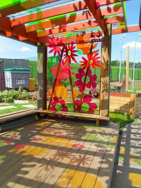 pergola with acrylic panels - I love the colored shadows