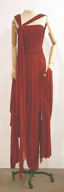 Dress by Jean Paul Gaultier, 2003: This evening gown shows elaborate draping and intentional uneven hem.