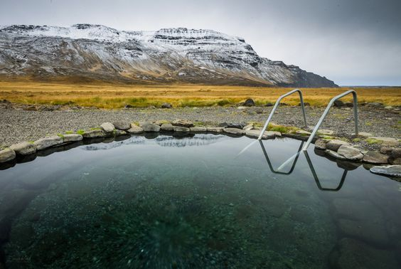 grettislaug geothermal pool in iceland with stairs
