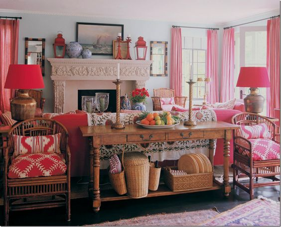 Mary mcdonald pink and red living room styled table behind sofa