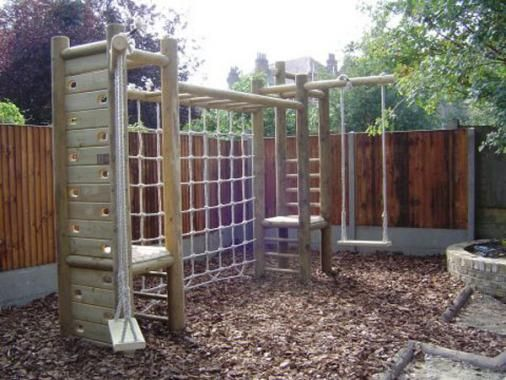 Double tower wooden climbing frame and scramble nets