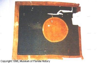 "Battle Flag of the 4TH REGIMENT Florida Volunteer Infantry.  Hardee pattern. Rectangular.  Size: 36"" x 40""  Bears unit designation (faded): 4th FLA  Battle honor (faded): MURFREESBORO  Not captured."