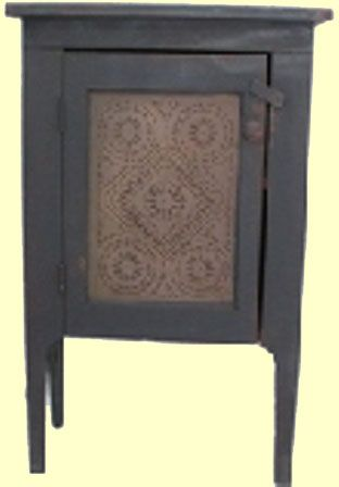 "This Tin Door Cupboard captures the true look and feel of Colonial America, recreating 17th, 18th, and 19th century primitive American country furniture.  It is an authentic design, handmade, then painted with an authentic milk paint color, and finished with a timeworn and aged patina, giving it that original old look.  Measures 31"" High x 21"" Wide x 11"" Deep"