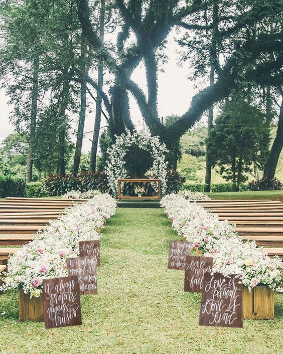 Rustic Wooden Wedding Aisle Signs / http://www.himisspuff.com/outdoor-wedding-aisles/
