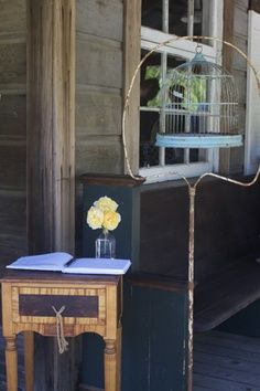 Rustic wedding decor | best stuff...love the bird cage and stand