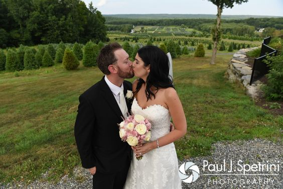 Lauryn and Justin embrace during a formal photo at their July 2016 wedding reception at the Overlook at Geer Tree Farm in Griswold, Connecticut.To see more photos from Justin and Lauryn's wedding, please visit http:// www.tinyurl.com/JustinAndLauryn (Copyright 2016: Paul J. Spetrini Photography)