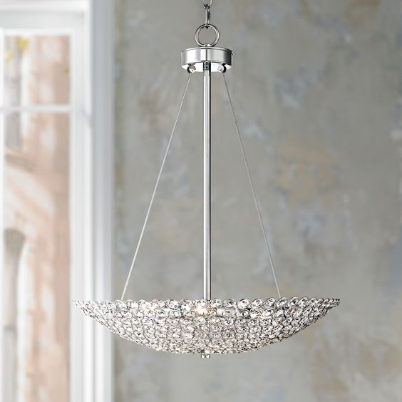 Easily add modern elegance to your home with this posh contemporary chandelier. Featuring shining crystal circles and a sleek chrome finish for glamorous style. From the Geneva Collection by Possini Euro Design.