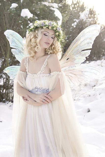 snow fairy - maybe nix the wings, but what to do if sun is shining through.  More organic feel to the snow.: