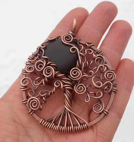 ...stocking up for upcoming Saturday market in Whycocomagh..:) Copper tre of life with beautiful black beach rock found in Cape Breton..For more designs please visit www.facebook.com/petra.leblanc