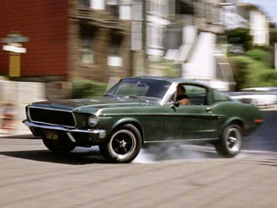 """Steve McQueen driving the famous '68 Mustang GT from the movie """"Bullitt"""".  One of the best movie car chases of all time."""