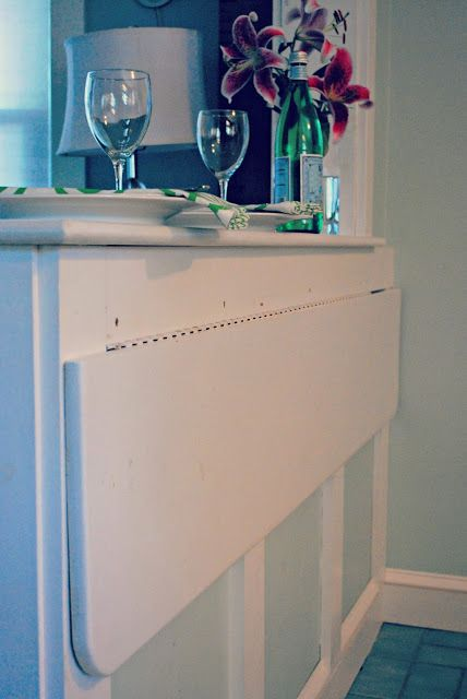 folding countertop below window.  Get panel to match window molding