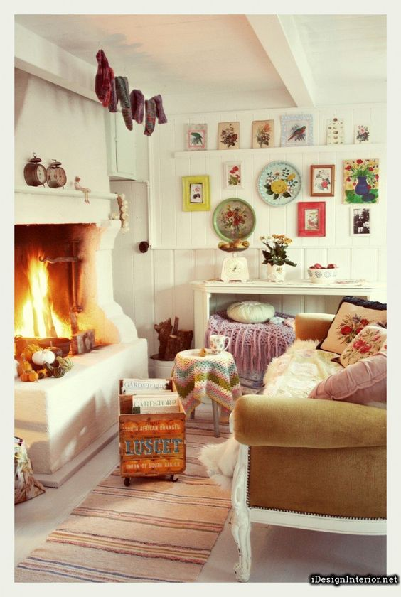 extraordinary white based bohemian style living room decoration with vintage brown fabric sofa and awesome fireplace bohemian style living room