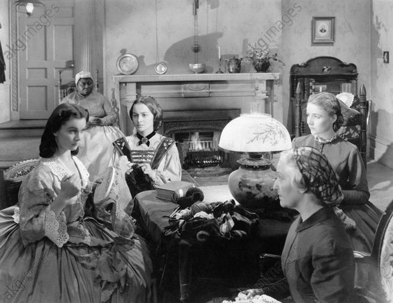 akg-images -Actresses Vivien Leigh (right) and Olivia De Havilland (left), as Scarlett O'Hara and Melanie Hamilton respectively, both committed to sewing and watched by Hattie McDaniel, who plays the role of housekeeper Mammy in a scene from the movie Gone with the Wind by Victor Fleming. USA, 1939.