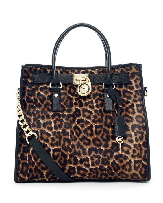 Beautiful leopard print handbag with black leather trim.