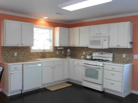 Coral kitchen Cottage style kitchen Peachy Keen wall color against