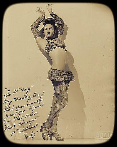 Exotic burlesque dancer shakes contents of bra vintage 3