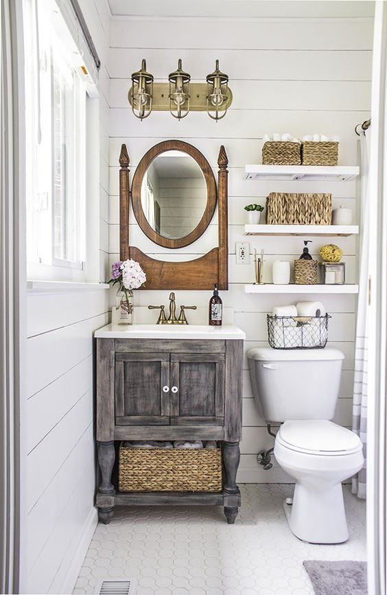 I like the vanity, but it's probably too rustic for our current design scheme. The floating shelves above the toilet are a good idea.