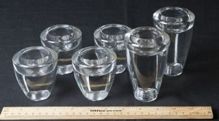 COLLECTION OF WEIGHTED GLASS CANDLE HOLDERS. 2 ARE 4 INCHES TALL AND 4 ARE 3 INCHES TALL