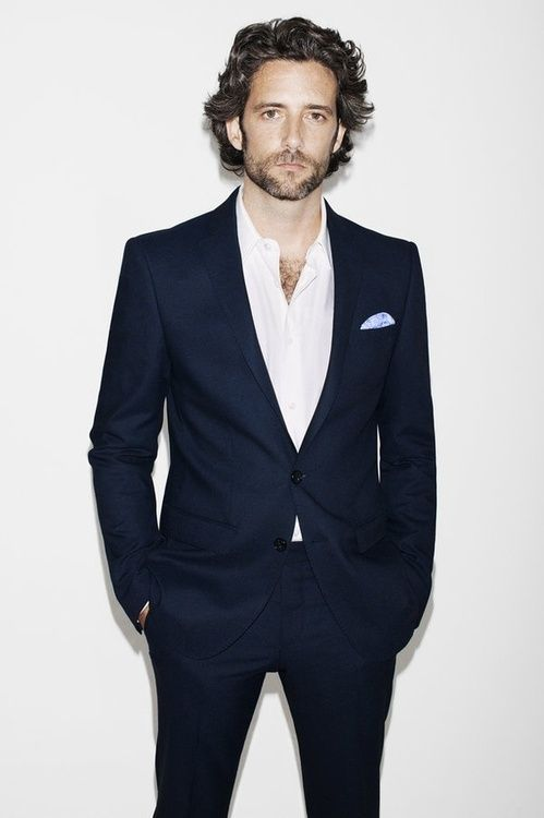 Navy blue suit, white shirt and a pocket square of your choice