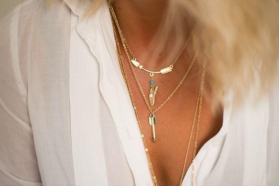Gold arrow necklaces.