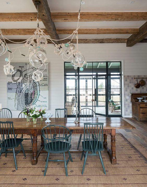 A modern farmhouse dining room by Jennifer Bunsa