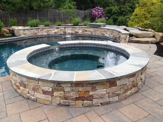 Landscaping landscaping contractors and stones on pinterest for Raised pool designs