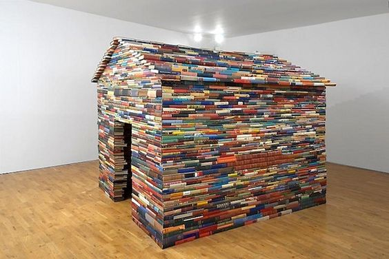 "Janet Cardiff and George Bures Miller made this 2008 piece, The House of Books Has No Windows.  The installation is of a house, made entirely out of antique books.  The house was created to offer "" … a space of infinite possibility where nothing may be read yet everything imagined."""
