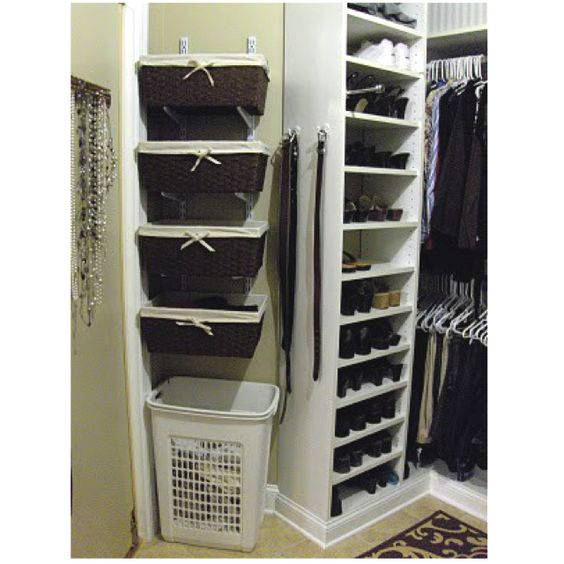 Baskets on wall mount brackets.  This could be the solution in our closet.