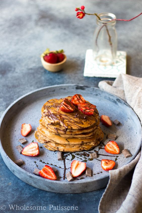 Vegan Chocolate Chip Strawberry Pancakes. Gluten free and sugar free. Filled with sweet strawberries and oozing chocolate. | wholesomepatisserie.com