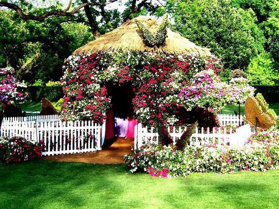 over the top flower hut with butterfly topiaries